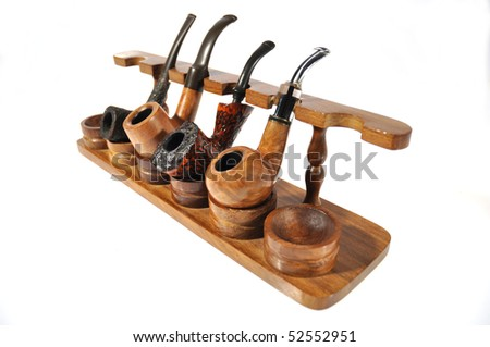 series of pipes of different shape cutlery appropriate support on a white background - stock photo