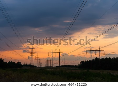 series of power lines on the background of orange sunset