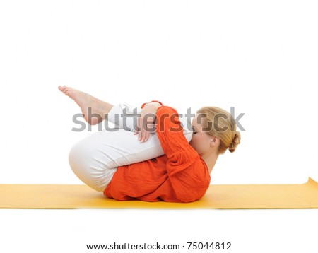 series or yoga photos. young woman in relaxation pose on yellow pilates mat