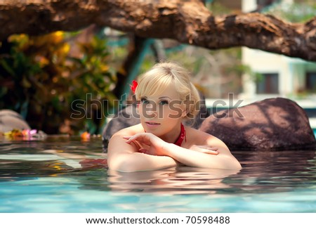 Series the beautiful girl lies in water with flowers - stock photo