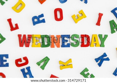"Series ""Weekday"": word Wednesday in wooden letters on white background"