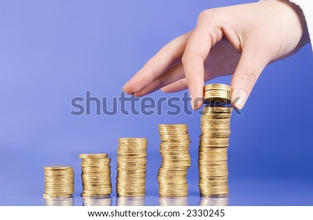 "series with columns of ""gold"" coins and fingers"