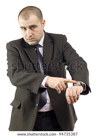 Serious adult businessman pointing to his watch.White background. - stock photo
