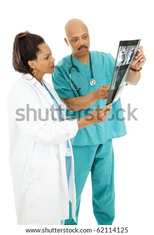 Serious African American doctors reviewing medical x-rays. Isolated on white.