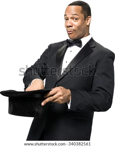 Serious African man with short black hair in evening outfit holding hat - Isolated