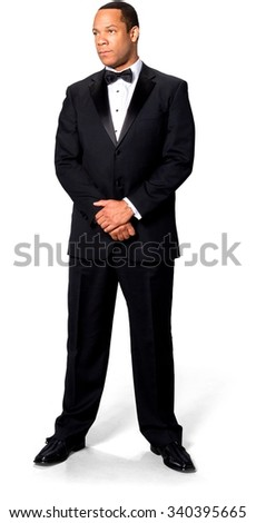 Serious African man with short black hair in evening outfit - Isolated