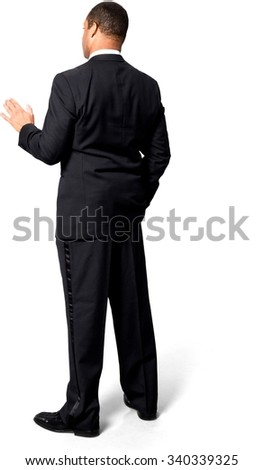 Serious African man with short black hair in evening outfit talking with hands - Isolated