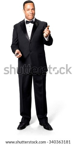Serious African man with short black hair in evening outfit using cigar - Isolated