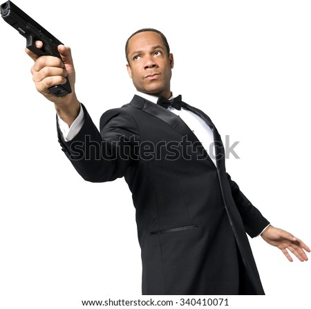 Serious African man with short black hair in evening outfit using handgun - Isolated - stock photo
