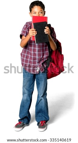 Serious African young boy with short black hair in casual outfit holding backpack - Isolated