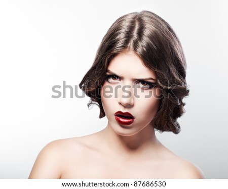 serious angry woman with red lips