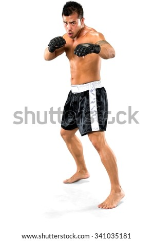Serious Asian man with short black hair in athletic costume being in boxing stance - Isolated - stock photo