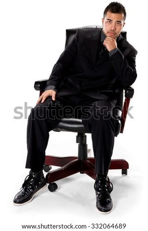 Serious Asian man with short black hair in business formal outfit with hands on thighs - Isolated