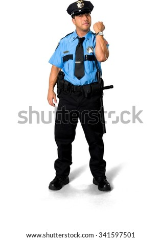 Serious Asian man with short black hair in uniform holding wristwatch - Isolated