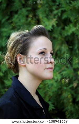 Serious Attractive Young Woman Looking Away From Camera - stock photo