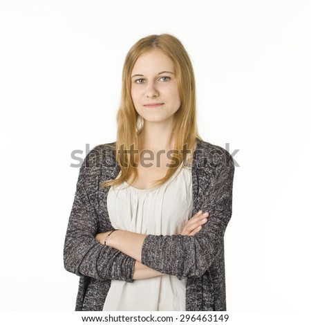 Serious blonde womam with crossed hands. - stock photo