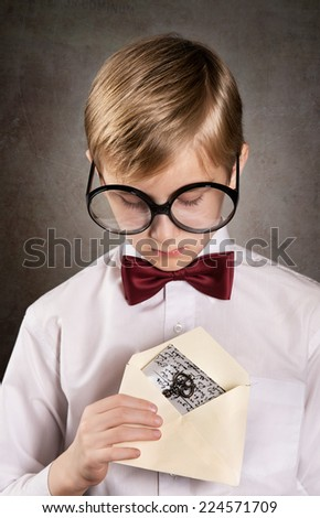 Serious boy with the letter. Retro style portrait - stock photo