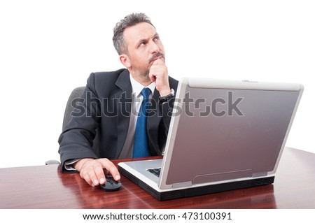 Serious broker thinking at some issues while sitting on office on white background