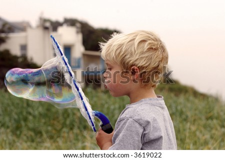 Serious Bubble blowing - stock photo