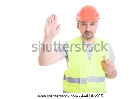 Serious builder rising his right hand and swearing false as lie and guilt concept isolated on white - stock photo