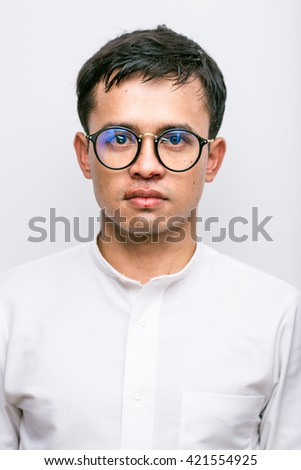 Serious business man white suit nosebleeds patient close-up on white background - stock photo
