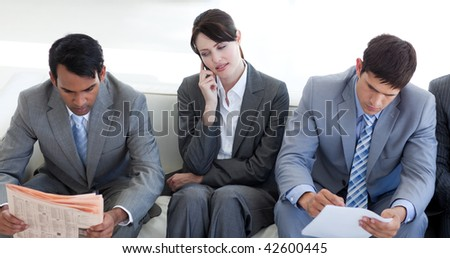 Serious Business people sitting and waiting for a job interview in an office - stock photo