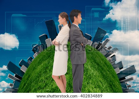 Serious business people standing back-to-back against scenic view of blue sky - stock photo