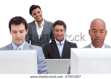 Serious business people working at computers in the office - stock photo