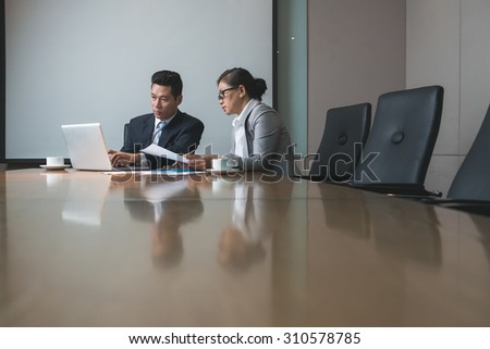 Serious business people working together in the office - stock photo
