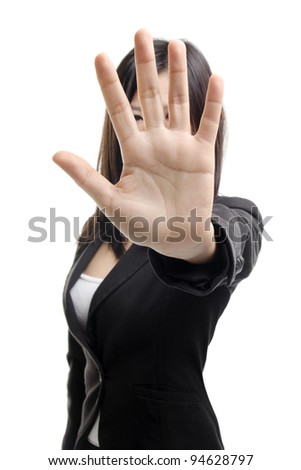 Serious business woman making stop sign over white background. Focus on hand - stock photo