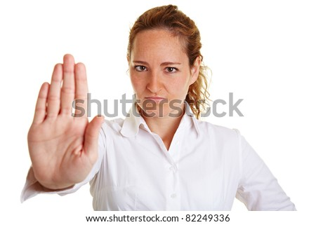 Serious business woman showing civil courage with her hand - stock photo