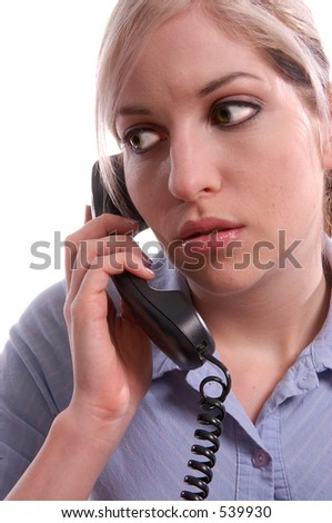 Serious business woman  talking on a cell phone