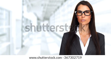 Serious business woman wearing eyeglasses.