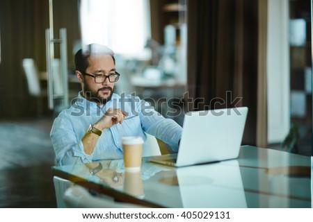 Serious businessman at work - stock photo