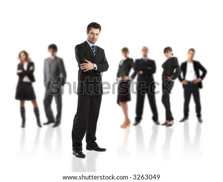 Serious Businessman - elite dream team - people in the background are out of focus - check my gallery for more pictures - stock photo