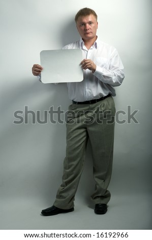 serious businessman hold white frame on gray background