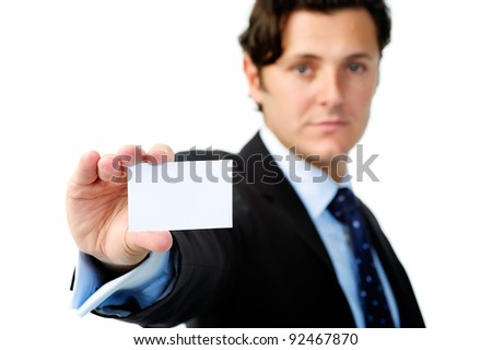 Serious businessman holding a blank card suitable for your company's contact details
