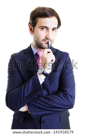 Serious businessman holding a pen with a suspicious attitude, isolated on white - stock photo