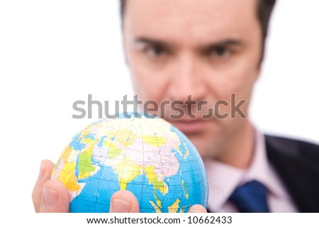 serious businessman holding mini globe on white background