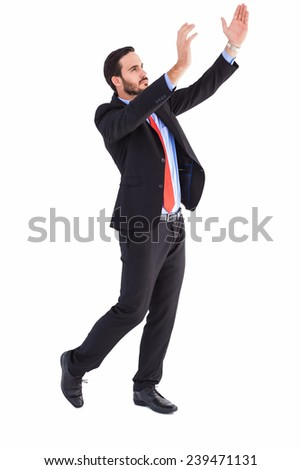 Serious businessman holding up with his hands on white background - stock photo