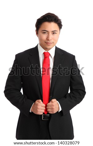 Serious businessman in a suit and red tie. White background.