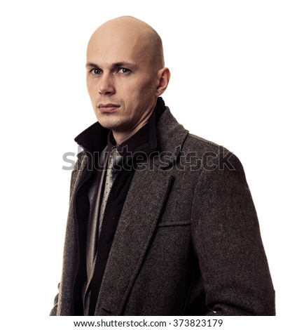 serious businessman in coat isolated on white background - stock photo