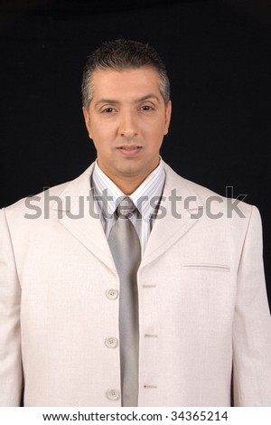 Serious businessman in front of camera - stock photo