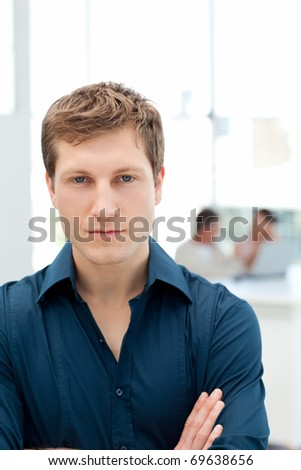 Serious businessman in his office at work - stock photo