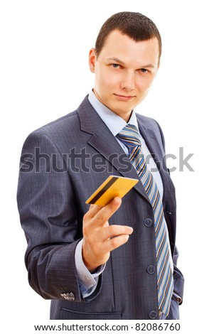 Serious businessman in suit with tie standing and holding gold plastic card isolated on white background. Mask included - stock photo