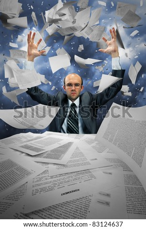 Serious businessman manipulating papers against dramatic blue sky - stock photo