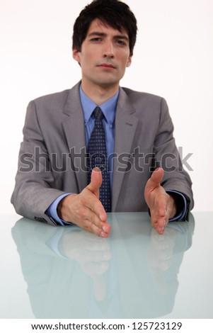 Serious businessman negotiating. - stock photo