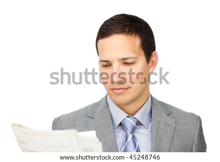 Serious businessman reading a newspaper against on a white background - stock photo
