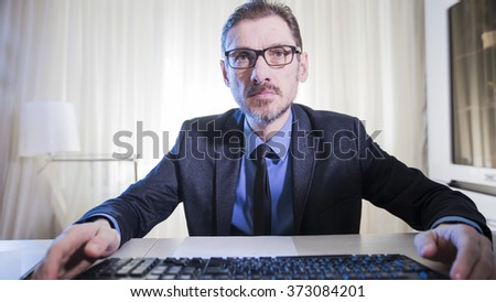 serious businessman sitting at his desk - stock photo