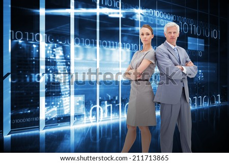 Serious businessman standing back-to-back with a woman against hologram interface in office overlooking city - stock photo